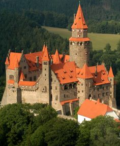 Bouzov Castle, located between the village of Hvozdek, and the town of Bouzov, west of Litovel, Moravia, Czechia.... http://www.castlesandmanorhouses.com/