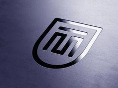 Logo concept for financial consultant MT, by Ronald Hagenstein.