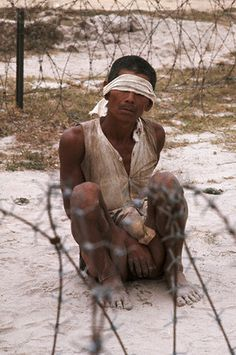 Vietnamese peasant, bound up and ready for interrogation ~ Vietnam War