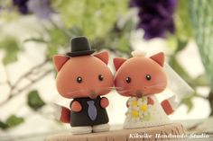 I think I need to start collecting cute wedding cake toppers.  SO adorable.