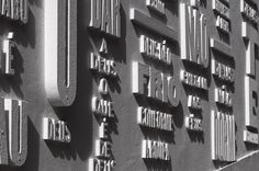 """Vai com Deus, Portugal    by R2 Design  2008-2009        """"Vai com Deus"""" was a typographic installation on the façade of the small chapel """"The Ermida Nossa Senhora da Conceição"""" in Belém, Portgal. Lizá Defossez Ramalho and Artur Rebelo designed the composition digitally and then cut the letters from MDF and fastened them to the wall using glue and screws. The installation was then sprayed with sand paint."""
