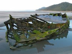 The 1891 shipwreck of the SS Lawrence on Mokihinui Beach New Zealand.