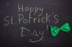 greeting card with st patricks day on blackboard