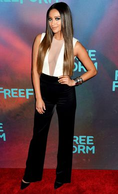 Shay Mitchell in a black-and-white sheer plunging jumpsuit