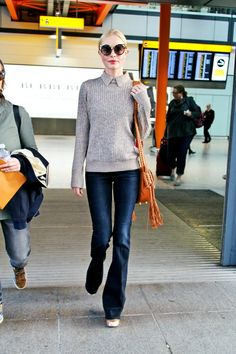 In Trademark Sweater, Frame Jeans And Altuzarra Bag - At Heathrow Airport, 2016
