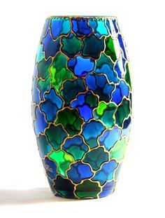 his vase was hand painted with different shades of green, turquoise and blue stained glass paints.