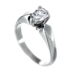 A diamond ring set in gold. It is set with One pear shaped I SI diamond. Pear Shaped, Princess Cut, White Gold, Wedding Rings, Engagement Rings, Jewels, Diamond, Classic, Style