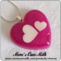 Resin pendants are made out of resin  and set in a mould to achieve the desired shape.  They can include milk beads, letters, umbilicals or images of your choice.  The pendants have a clasp attached to the back which is used to hang it on a necklace.  They are available in a variety of shapes and sizes and can be personalised in a colour of your choice