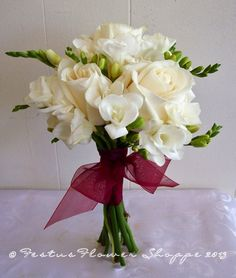 White rose and freesia bridal bouquet Freesia Bridal Bouquet, Rose Bouquet, Wedding Bouquets, Wedding Flowers, Winter Wedding Inspiration, Corsage, White Roses, Fresh Flowers, Sally