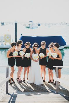 Cool pic of the bride and her besties. {Bridesmaids in black cocktail dresses and vintage inspired jewelry}.