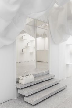 Snarkitecture creates billowing all-white pop-up store for Valextra in Milan