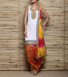 White & Yellow Printed Malmal Patiala Salwar Kameez With Gota Work