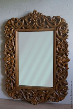 The frame for the mirror is executed on motives of openwork woodcarving.  Relief carving with the selected background.