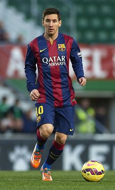 Lionel Messi of Barcelona runs with the ball during the La Liga match between Elche FC and FC Barcelona at Estadio Manuel Martinez Valero on January 24, 2015 in Elche, Spain.
