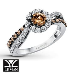 Brilliantly framed in round Vanilla Diamonds®, the center of this stylish ring for her is a delectable Chocolate Diamond. Additional rows of Le Vian Chocolate Diamonds® and Vanilla Diamonds® intertwine on either side of the 14K Vanilla Gold® band to complement. The total diamond weight is 1 carat. Le Vian®. Discover the Legend. Diamond Total Carat Weight may range from .95 - 1.11 carats.