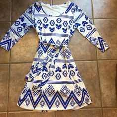 Brand new white and blue print dress Bought at a boutique, brand new never worn! Blue fun print over white with 3/4 sleeves. Not see through because it has white lining (shown in pic 3). Comes with detachable matching belt. Dresses Mini