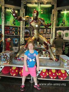 Ali in front of an Iron Man display at Universal Orlando.