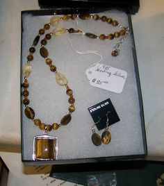 Tiger Eye Golden Sterling Pendant with Faceted Tiger Golden Eye, Faceted Citrine and Tiger Eye Golden Beads, 1 and 1/2 inch adjustment chain, free faceted Tiger Eye Golden earrings .925 Tiger eye comes from Africa. Faceted stones are much more valuable normally.
