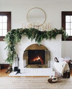 Asymmetrical garland: an unexpected take on traditional Holiday fireplace mantel decor. Hear my thought process and how to create the look at your house. christmas fireplace Asymmetrical Garland DIY - Francois et Moi