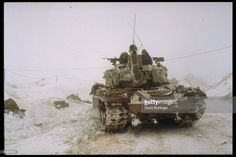 Israeli soldiers aboard snowbound (US-made) M-60 tank during Lebanon War, aka. Peace for Galilee invasion.