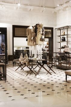 Inside Burberry 121 Regent Street, London, the new Burberry World Live Flagship...the detail running along the top of the walls in gorg. Same wall shelves in brushed gold would be cool