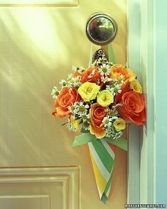 Flower Cones     A popular May Day tradition of leaving a basket of treats or flowers on a neighbor's doorstep inspired this striped cone -- the handle makes it easy to hang posies from a friend's door.   ... See directions at Martha Stewarts website by clicking image.
