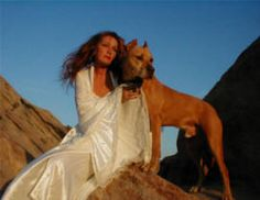 Tia and her pitbull Duke. He was her first rescue and she adopted him. He eventually passed away due to cancer at the age of 15. He is the logo for the rescue center of Villalobos and stands for everything they do. His ashes are scattered at her former ranch in California. What a beautiful dog!!!  pitbulls and parolees