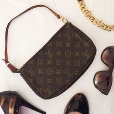 Louis Vuitton pochette Authentic Louis Vuitton pochette. Used condition. Please see pics for the wear on hardware and strap. Date code is SD0081. Comes with the original dust bag. Please, no trades. Louis Vuitton Bags Shoulder Bags