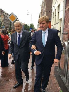 A touching moment...Dutch King Willem Alexander supports Eberhard van der Laan, the mayor of Amsterdam. The mayor is seriously ill. He has lung cancer with metastases. The photo was taken during a walk in 'De Jordaan', a popular area in Amsterdam (Sept. 2017) http://www.at5.nl/artikelen/172853/bijzonder_moment_toont_sterke_band_burgemeester_en_koning / N.B. the mayor died Oct. 5 2017
