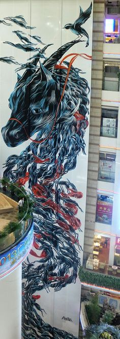 Portuguese street artist Pantónio recently painted a massive mural called Long Ma Jinjsxiu in Guangzhou
