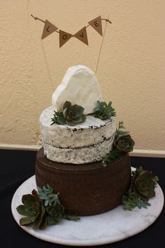 A rustic wedding cake designed by Barossa Valley Cheese Company in Angaston, Barossa Valley in South Australia. Floristry by Miss Maggies Flowers also in Angaston.