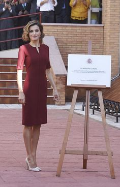 Queen Letizia looked her typical super-chic self in a burgundy knee-length dress.  Wearing nude high heels and matching deep red earrings, Queen Letizia looked as stylish as ever