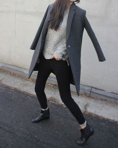 Black skinny jeans, black ankle boots, light grey sweater, dark grey coat
