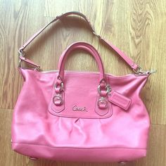 Coach pink purse In great condition. Gently used. Handles with shoulder strap. Could be worn both ways!!! Great pink salmon color perfect for the summer! Zip pocket on the inside with an extra pocket. Can also fit lots of stuff! I can usually fit my full size wallet, keys, iPhone, cosmetic pouch and water bottle and still has room for more! Price negotiable so make an offer! Coach Bags Shoulder Bags