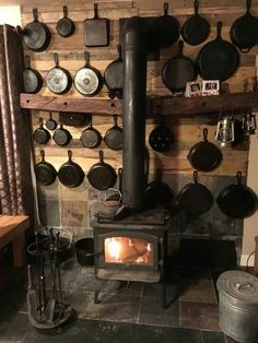 Cast iron storage and that wood stove 😍 Cabin Homes, Log Homes, Rustic Kitchen, Country Kitchen, Ideas Cabaña, Booth Ideas, Iron Storage, Cabin Kitchens, Cast Iron Cookware