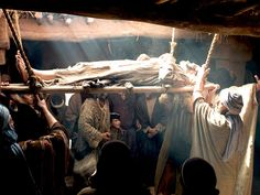 A paralysed man's friends make a gap in the roof to lower him to Jesus. (Mark 2:2-12, Luke 5:17-26): Free Visuals