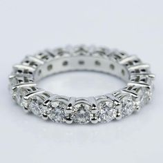 Custom Shared-Prong Platinum Diamond Eternity Ring (4 ctw.)