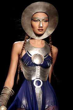 Jean Paul Gaultier. digging the breast plate and jewelry more than the dress