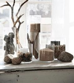 Rustic doesn't have to equal taxidermy animals and knotty pine. Some of the most attractive uses of natural elements are the ones employed with the most restraint. Adding a few outdoor objects into even the most minimalist of spaces provides warmth and interest without overpowering the rest of the decor...