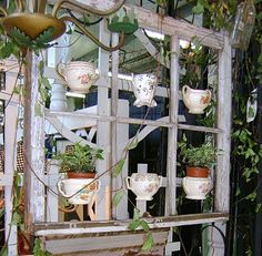 Fun things to do with old window frames. I have a lot of cream pictures and sugar bowls a so can do this for my garden shed Recycled Windows, Old Windows, Windows And Doors, Antique Windows, Vintage Windows, Garden Whimsy, Garden Junk, Herb Garden, Old Window Projects