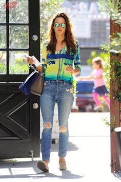Alessandra Ambrosio wearing Elyse Walker Los Angeles Dee Suede Espadrille Loafers, Krewe Du Optic St. Louis Sunglasses, Mother X Candice Swanepoel the Stunner Jean, Minnie Rose Tencel Cotton Palm Tree Print V-Neck Sweater and BaubleBar X Ale by Alessandra Ambrosio Necklace