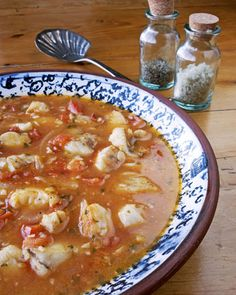 Fish Stew......made my own Italian ciappino last night, tons of veggies, spicy, with talapia, bay scalops, and shrimp; served over cheesy gruyere grits. Good for the soul food. Serve with a simple salad and lemon cake for dessert.