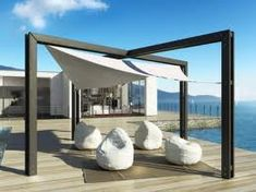 Modern Pergola. Envision without the shade, used as a ceremony area. It could be wooden or painted white. Dripping with vines of ivy and fern, and other spring-like greenery and flowers.