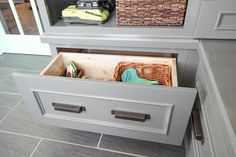 Deep drawers like this one serve as beautiful and functional storage for sportswear, shoes and other outside gear. Featured: KraftMaid® Lincoln Maple Cabinetry in Greyloft and pulls from the Fordham Collection. Outdoor Furniture, Outdoor Decor, Mudroom, Building A House, Drawers, Organization, Organizing, New Homes, Storage Ideas