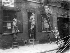 Women window cleaners working in Nottingham during the first world war, in 1917.
