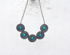 Handmade Turquoise Circles zipper necklace.    Also available in golden.        Feel free to contact me with any questions