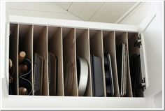 Building a kitchen? Install a special cabinet over the refrigerator to hold all of your baking sheets.