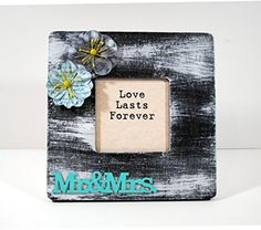 "Hand Painted Distressed ""Mr & Mrs"" Wood Frame Black White Gray Turquoise ""Love Last Forever"" Wedding, Anniversary Gift. Mr & Mrs. Love lasts forever! You can insert your photo to replace the text that comes with the frame. This beautiful wooden frame is lovingly hand painted and embellishment by me in my smoke free / pet free studio. The frame and the word cutout are made of wood, flowers from paper! Frame size is approximately 8"" x 8"" Picture opening is approximately 3.5"" x 3.5"" Stands on…"