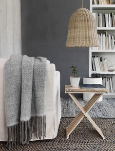 Cosy living room with neutral colours and natural textures. Want. That. Throw.