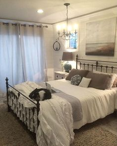 Iron headboard in a neutral guest room.